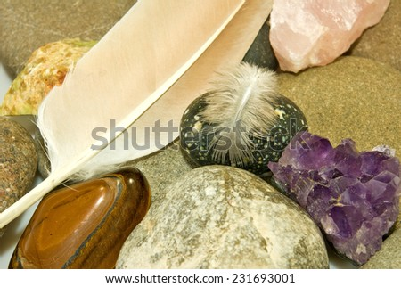 image of various stones and feather - stock photo