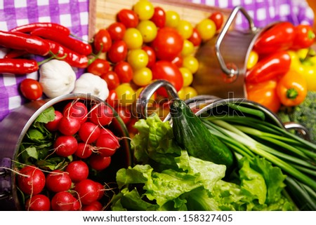 Image of vegetables on the table and in the pot