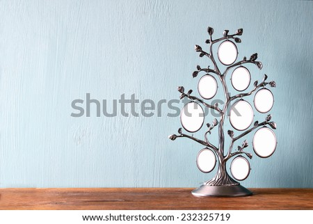 Image of vintage antique classical frame of family tree on wooden table  - stock photo