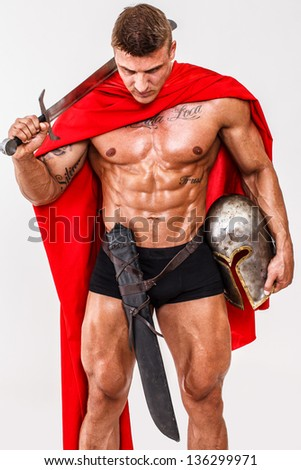 Image of warrior who is looking on the ground - stock photo