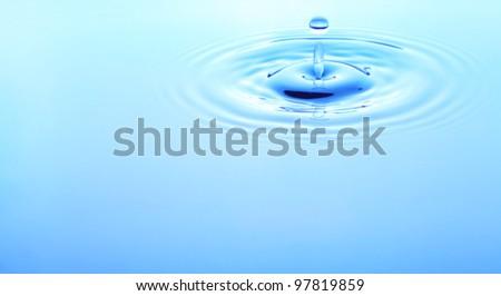 Image of water drop closeup - stock photo