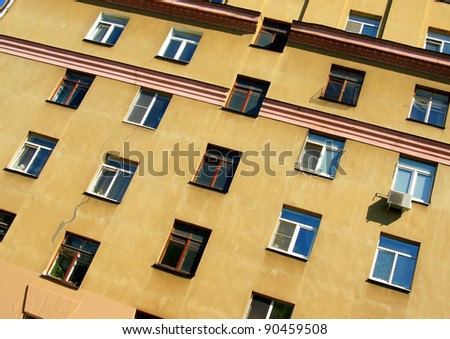 image of windows on a wall of an old building - stock photo