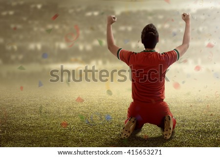 Image of winning football player after score in a match - stock photo