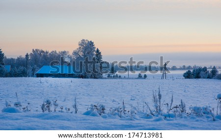 Image of winter sunset in the countryside - stock photo