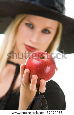 Image of witch giving red ripe apple to somebody