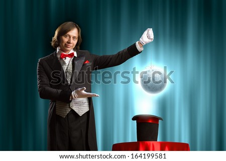 Image of wizard showing tricks with his hat. Ecology concept - stock photo
