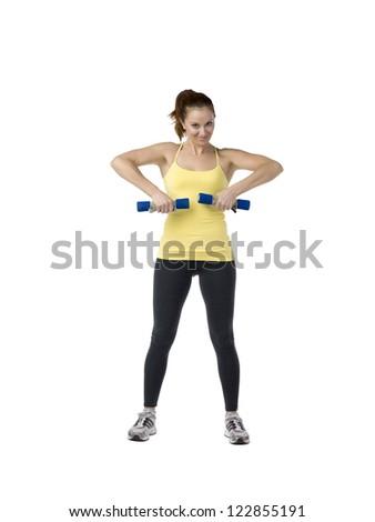 Image of woman exercising using dumbbells against white background - stock photo