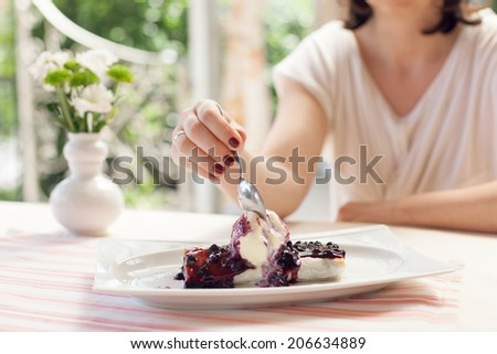 Image of woman having dessert in cafe - stock photo