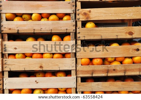Image of wooden crates full of oranges. - stock photo