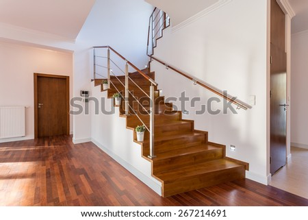 Image of wooden staircase in front hall - stock photo