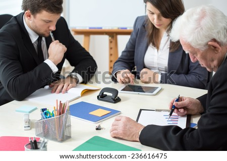 Image of workers of corporation during their work - stock photo