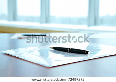 Image of workplace with folder and pen on it - stock photo