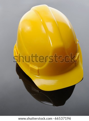 Image of yellow construction helmet on a black background - stock photo