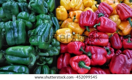 Image of yellow, green and red capsicum  - stock photo