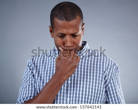 Image of young African man in trouble - stock photo