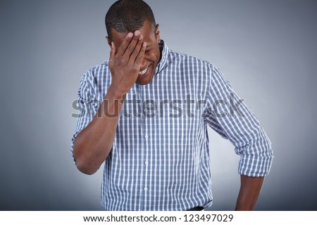 Image of young African man touching his head in surprise - stock photo