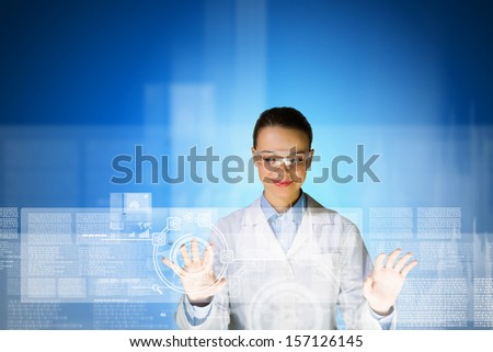 Image of young attractive woman scientist in protective eye wear - stock photo