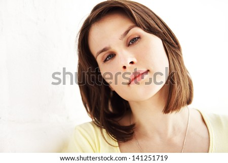 Image of young beautiful woman over white background - stock photo