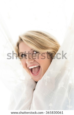 Image of young blonde girl playing around having fun - stock photo