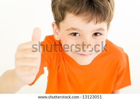 Image of young boy raising hand and showing sign of okay - stock photo