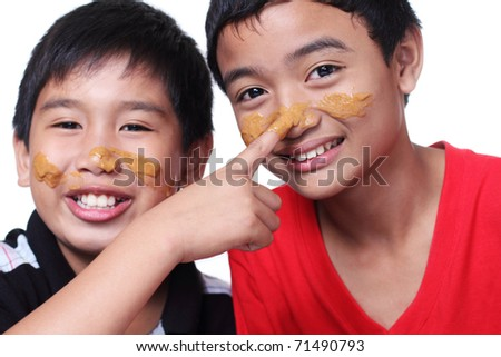 image of young boys with smeared faces - stock photo
