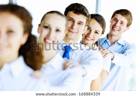 Image of young business people standing in line. Interaction concept - stock photo