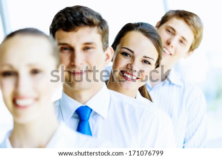 Image of young business people standing in line. Interaction concept