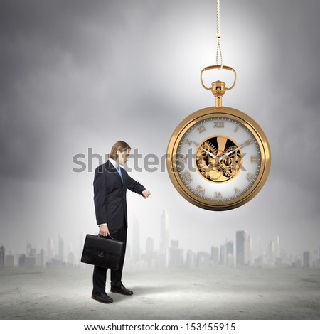 Image of young businessman and pocket watch. Time concept - stock photo