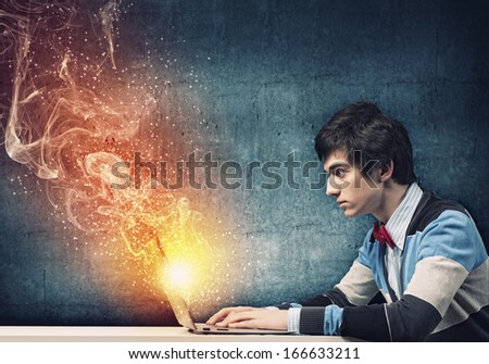 Image of young businessman at work using laptop - stock photo