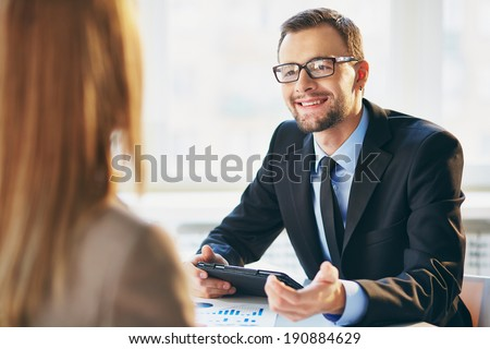 Image of young businessman interviewing female - stock photo