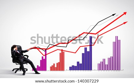 Image of young businessman pulling graph. Chart growth concept - stock photo