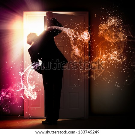 Image of young businessman standing with back opening door against smoke background