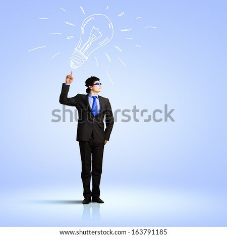 Image of young businessman with light bulb. New idea and inspiration