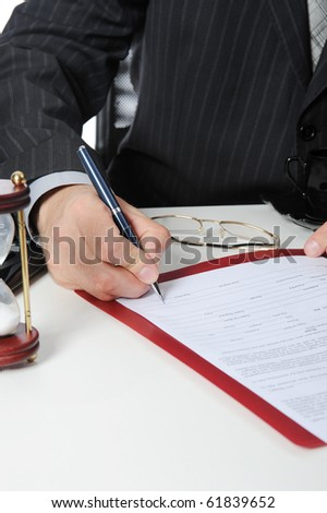 Image of young businessmans hand ready to make signature - stock photo