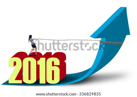 Image of young businesswoman pulling a blue arrow upward with a rope while standing on numbers 2016 - stock photo