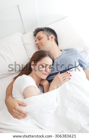 Image of young couple asleep