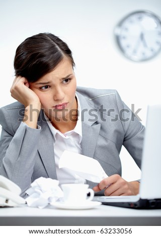 Image of young employer looking at laptop with troubled expression - stock photo