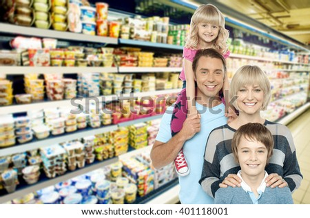 Image of young family grocery shopping in supermarket - stock photo