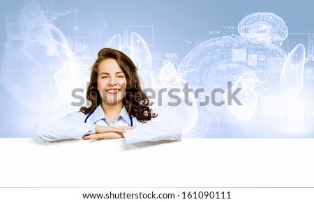 Image of young female doctor with blank banner. Place for text - stock photo