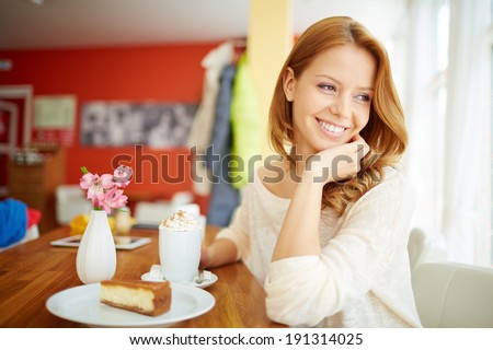 Image of young female enjoying dessert in cafe - stock photo