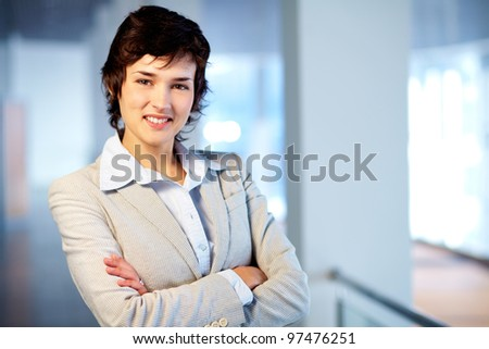 Image of young female looking at camera - stock photo