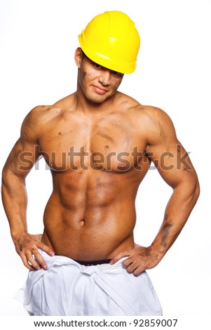 Image of young handsome builder posing, isolated on white
