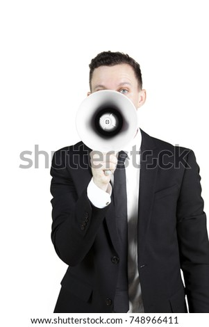 Image of young male manager speaking through a megaphone in the studio, isolated on white background