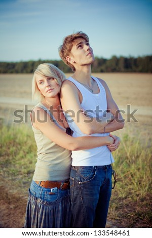 Image of young man and woman on the road - stock photo