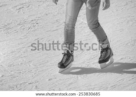 Image of young man who are ice skating at the ice rink outdoors at Medeo - stock photo