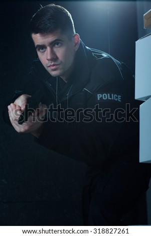 Image of young man working as policeman - stock photo
