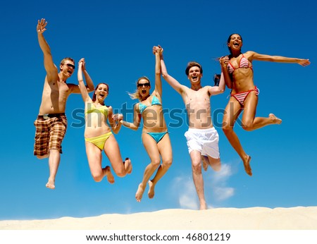 Image of young people jumping together outdoor - stock photo