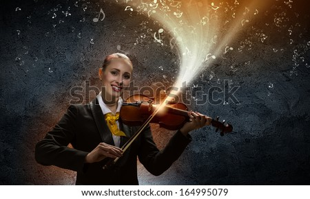 Image of young smiling businesswoman playing violin