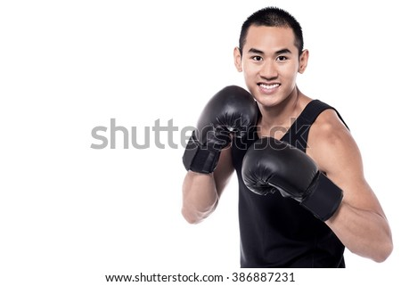 Image of young sportsman who is boxing - stock photo