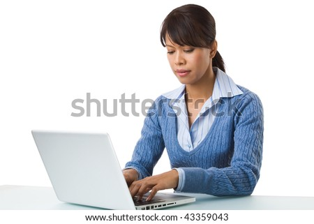Image of young successful employer typing on laptop at workplace - stock photo